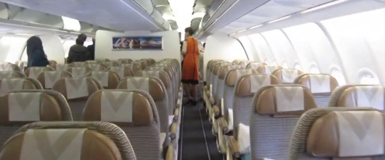 virus corona saat naik pesawat